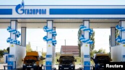 Russia -- Vehicles are seen at a gas filling station, owned by Gazprom Transgaz Stavropol, with the company logo of Russian natural gas producer Gazprom seen on the station, in Stavropol, October 9, 2013