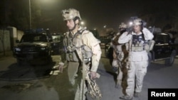 Бойцы афганского спецназа прибыли к месту атаки талибов в Кабуле. 11 декабря 2015 года.