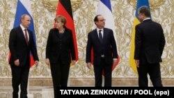 Лідери України, Німеччини, Франції та Росії під час зустрічі у «нормандському форматі». Мінськ, 11 лютого 2015 року