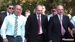 Nagorno-Karabakh -- Armenian President Robert Kocharian (L), newly inaugurated Karabakh President Bako Sahakian (C) and his predecessor Arkadi Ghukasian walk in Stepanakert, September 7, 2007.