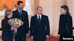 استقبال ولادیمیر پوتین و همسر سابقش از بشار اسد و همسرش در مسکو، ژانویه ۲۰۰۵