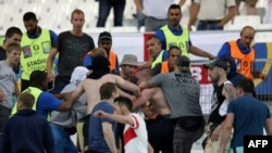 When the game ended in a 1-1 draw, Russian supporters attacked English fans in the stadium in fighting that continued in the city afterward.