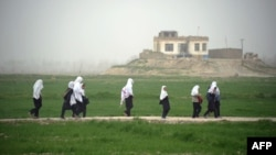Girls walk home from school in Konduz Province. When it ruled Afghanistan, the Taliban banned girls from attending school.