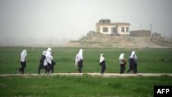 Girls walk home from school in Konduz Province. When it ruled Afghanistan, the Taliban banned girls from attending school.