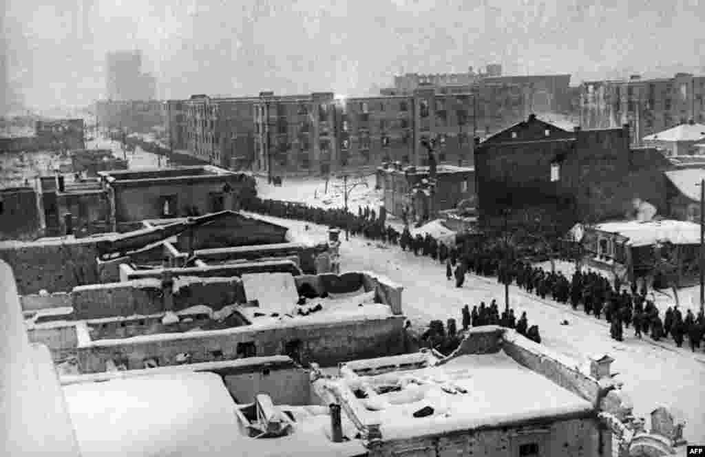 Columns of Nazi German Wehrmacht soldiers pass through the streets of Stalingrad on February 1, 1943.