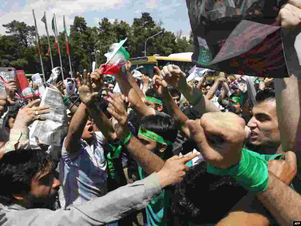 Ahmadinejad and Musavi backers confronted each other outside Tehran University after Friday prayers on June 6.