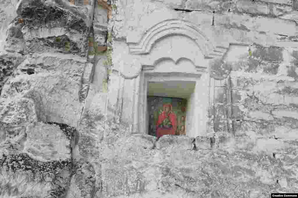 A copy of the Sicilian Virgin Mary icon looks out from the facade of the temple. When the debate over ownership of the temple made local headlines, a commission was formed that will oversee a public discussion of the issue.