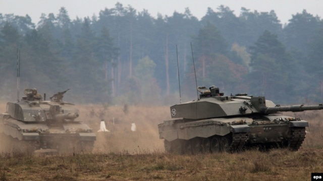 British battle tanks are seen during a NATO military exercise in Poland in October.