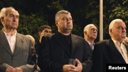 Outgoing South Ossetian leader Eduard Kokoity takes part in a commemoration ceremony, marking the third anniversary of Georgia's war with Russia in Tskhinvali on August 7, 2011.