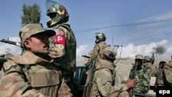 Pakistani Army soldiers patrol in Miran Shah near the Pakistani-Afghan border.
