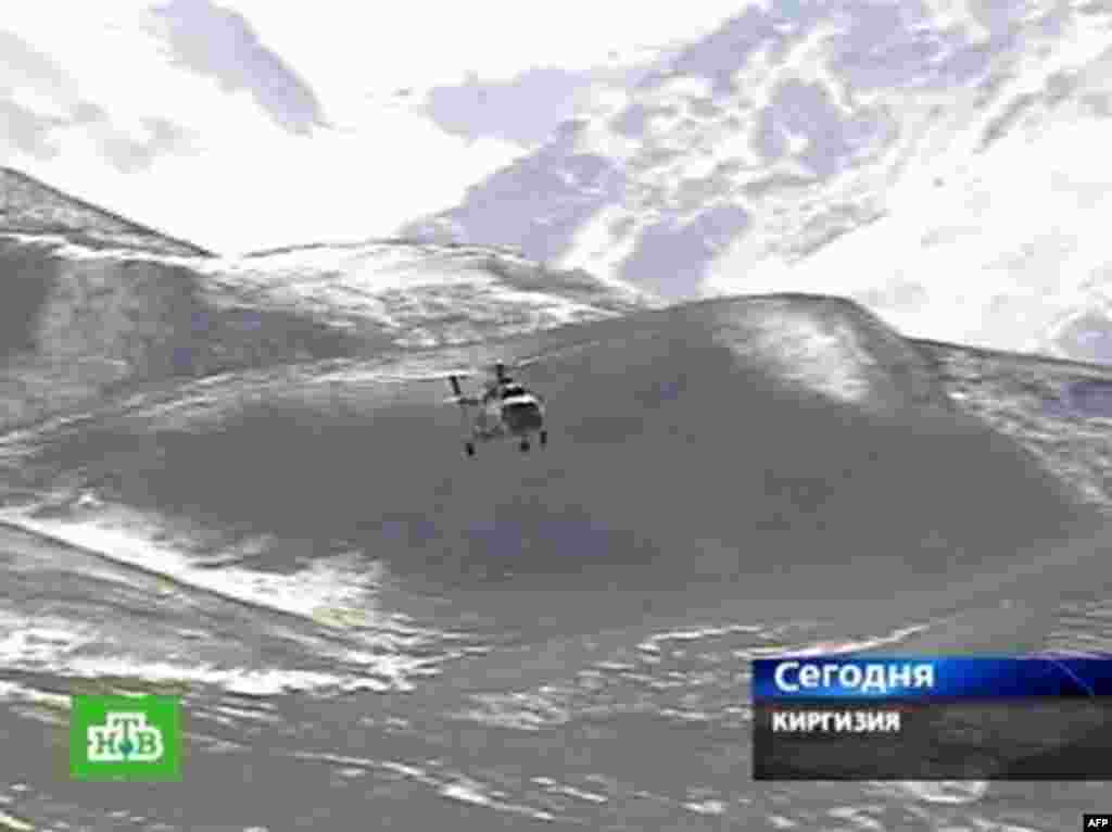 A helicopter from the Kyrgyz Emergencies Ministry flies to the devastated village of Nura. - A Russian NTV channel television grab shows a Kyrgyz Emergencies Ministry helicopter at an unnamed location near Osh flying to the village of Nura in the isolated Alaisky district on October 6, 2008. A strong earthquake hit Kyrgyzstan, killing 65 people mainly in a remote village near the border with China that rescuers were racing to reach, officials said.