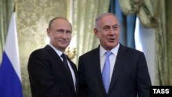 Russian President Vladimir Putin (left) meets with Israeli Prime Minister Benjamin Netanyahu at the Kremlin in Moscow on June 7.