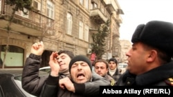 "Youth activists are corraled by police in Baku on March 11, when Facebook activists called for ""Great People's Day."""