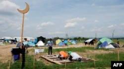 Greece -- Muslims pray at a makeshift camp for migrants and refugees near the village of Idomeni not far from the Greek-Macedonian border, May 2, 2016