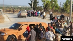A checkpoint maintained by Al-Qaeda's onetime affiliate, Nusra Front, in Syria's Idlib province