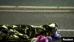 France -- A body is seen on the ground July 15, 2016