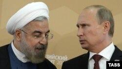 از راست: پوتین و روحانی، رئیسان جمهوری روسیه و ایران، طی دیداری سپتامبر ۲۰۱۴