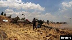 Սիրիացի ապստամբները կառավարական ուժերի հետ մարտի ժամանակ, հունիս, 2015թ․