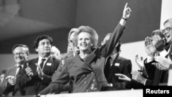 British Prime Minister Margaret Thatcher receives a standing ovation at the Conservative Party Conference on October 13, 1989.