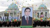 TURKMENISTAN -- People carry a picture of Turkmen President Gurbanguly Berdymukhammedov to mark Turkmenistan's Independence Day in Ashgabat on October 27, 2009.