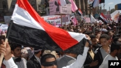 "Yemeni antigovernment protesters shout slogans during a ""day of rage"" protest in Sanaa."