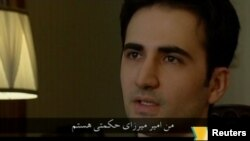 A man who identifies himself as Amir Mirza Hekmati appears on Iranian state television.