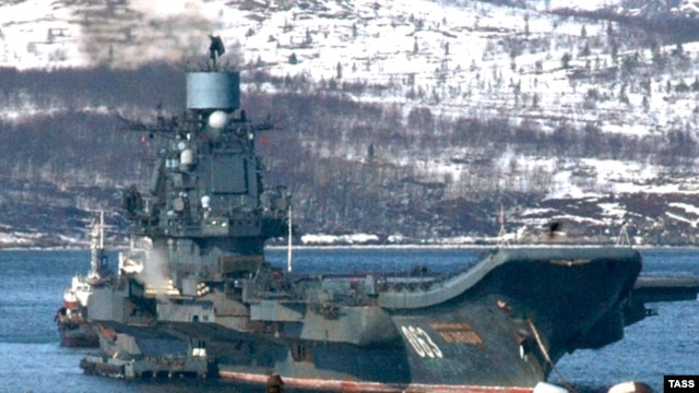 "Russia's ""Admiral Kuznetsov"" aircraft carrier cruises near Severomors in 2009."