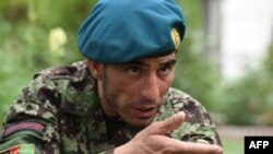 Afghan soldier Essa Khan Laghmani was honored for foiling a Taliban Taliban attack on the Afghan parliament in June 2015.