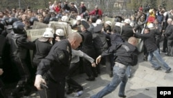 Police officers clash with demonstrators during anti-communist demonstrations in Chisinau on April 7.