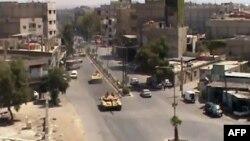 Snimak sa videa koji pokazuje tenkove pro vladinih snaga u delu Damaska