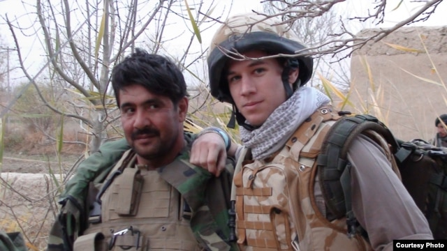 Patrick Hennessey (right) poses with Qiam, an Afghan National Army officer, in Helmand in 2009.