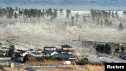 Japan -- A massive tsunami sweeps in to engulf a residential area after a powerful earthquake in Natori, Miyagi Prefecture, 11Mar2011