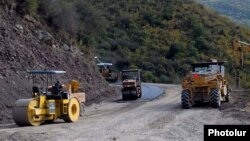 Armenia -- Workers refurbish a road in Syunik region.
