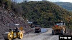 Armenia -- Workers refurbish a road in Syunik region.