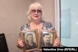 Georgeta Ureche cu portretele părinților deportați