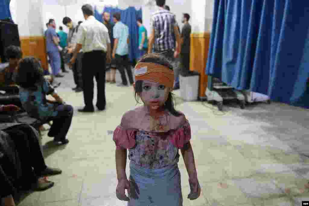 """Фотография Абд Думани, занявшего второе место в категории """"Новости"""". Сирия, походный госпиталь в городе Доума."""