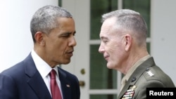 U.S. President Obama (L) greets Marine Corps' Commandant Joseph Dunford after nominating Dunford to be the next Joint Chiefs chairman, during an event in the White House Rose Garden on May 5.