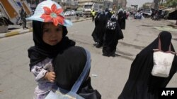 Shi'ite pilgrims travel to the Kadhimiya shrine in north Baghdad on June 14 to commemorate the death anniversary of Imam Musa Kadhim.