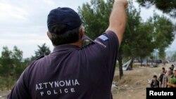 Грекия полициясы (Көрнекі сурет).