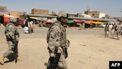 U.S. soldiers patrol the streets of Kabul earlier this month