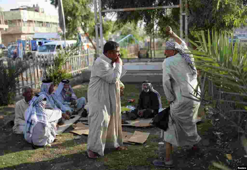 Men relax in Sadr City.