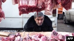 Georgia -- A vendor sells meat for the New Year meal on a street market in Tbilisi, 29Dec2009