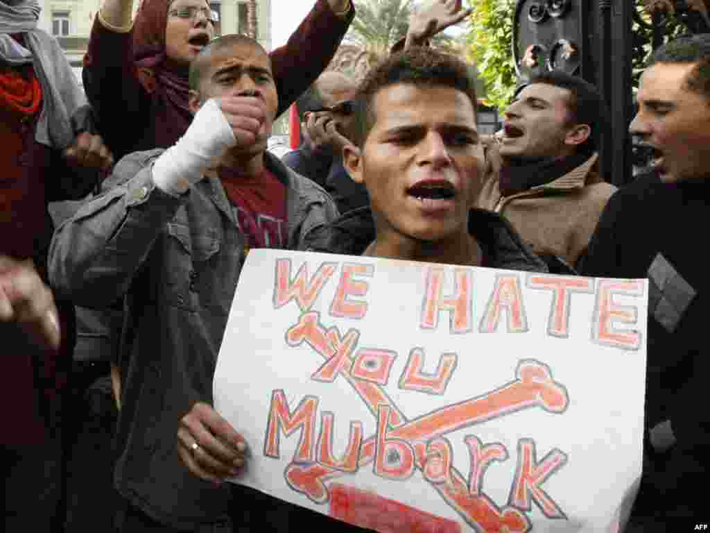 Anti-government demonstrators shout slogans in Cairo on January 27.