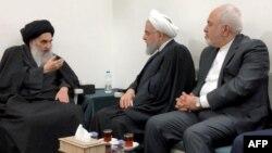 Ali Sistani (solda), Prezident Hassan Rouhani (ortada) və Xarici işlər naziri Mohammad Javad Zarif (sağda) Nəcəfdə görüşür, arxiv fotosu