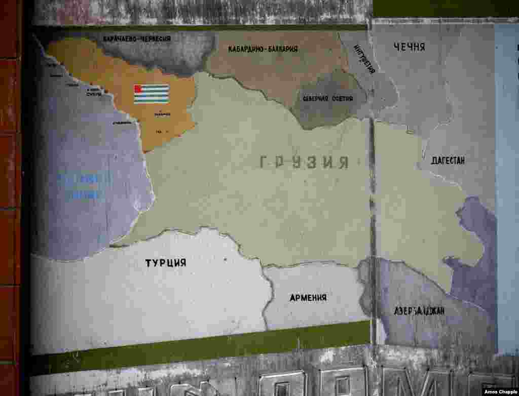 An old sign shows the territory of Abkhazia at top left, with the rest of Georgia in the center.