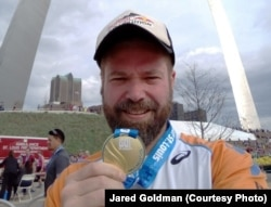 Jared after finishing half-marathon in St. Louis. It was his first run in the US and the first time his parents saw him run