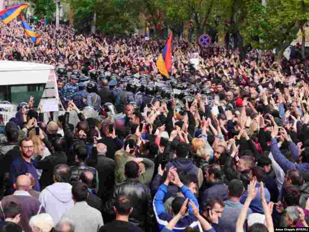 Protesters gather outside a police station in Yerevan.