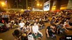 Участники массовых протестов в Гонконге.