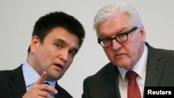 German Foreign Minister Frank-Walter Steinmeier (right) and Ukrainian Foreign Minister Pavlo Klimkin attend a news conference in Kyiv on February 23.