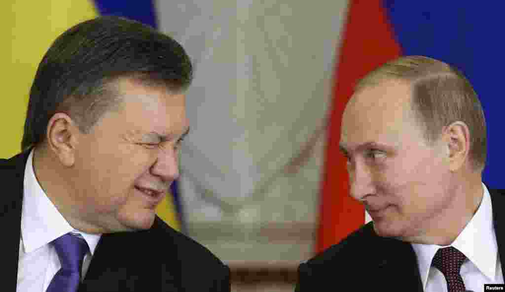 Ukrainian President Viktor Yanukovych (left) gives a wink to his Russian counterpart Vladimir Putin during a signing ceremony after a meeting of the Russian-Ukrainian Interstate Commission at the Kremlin in Moscow, on December 17. (Reuters/Sergei Karpukhin)